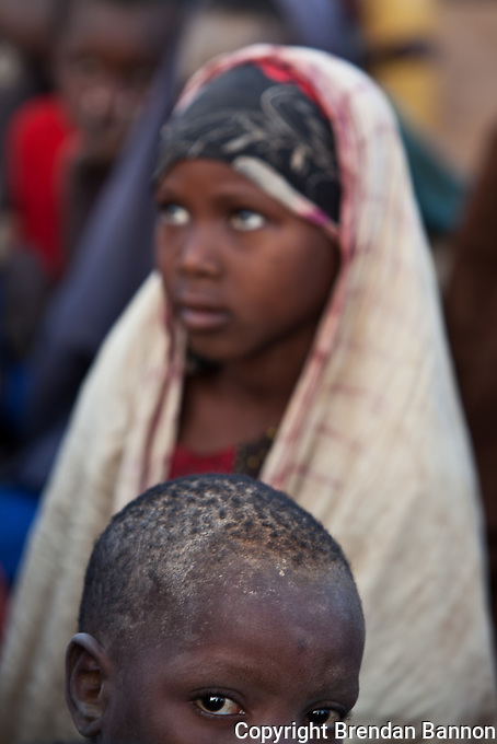 Refugees who have just arrived at Dadaab refugee camp wait at a reception area in the first days after arriving. The emergency situation has created a backlog for the registration process, which is key for refugees to get a regular, predictable and adequate supply of food.