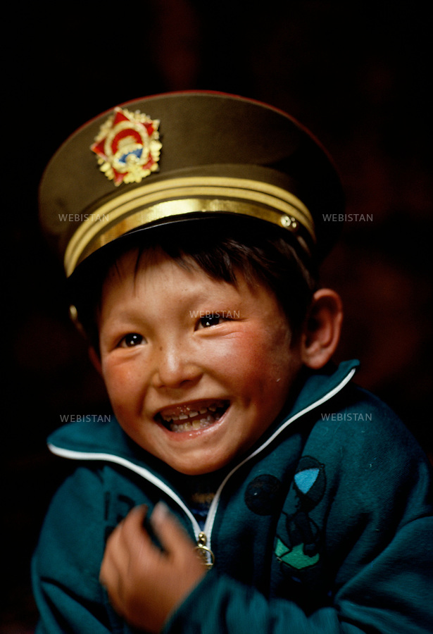 1994. Portrait of a little Kazakh boy wearing a military Chinese cap. Portrait d'un petit gar&ccedil;on kazakh coiff&eacute; d'une casquette militaire chinoise.<br />