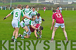 Dromid's Chris Farley shows great determination as he finds himself surrounded by the men from Kanturk.