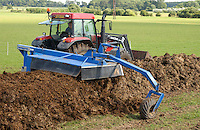 Aerating compost using a Traymaster tractor pulled windrow turner.