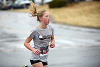 NWA Arkansas Democrat-Gazette/DAVID GOTTSCHALK Ava Sawyer, 13, finishes first in the women's 5K division Thursday, November 28, 2019, in the Springdale Turkey Trot at Shiloh Square in Springdale. The event, organized by the Red Dog Club who supports the Springdale High School Bulldogs, featured a  5k, 10k and fun run.