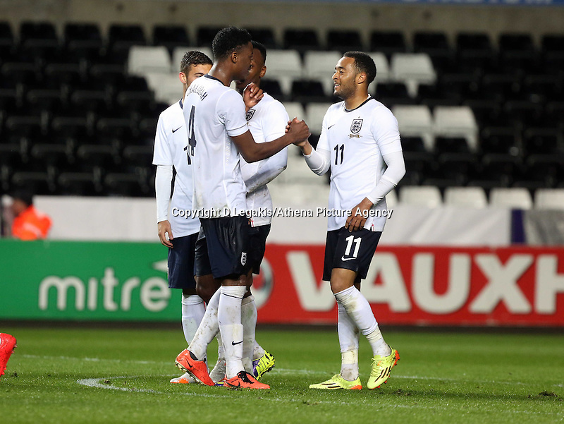 Pictured: Nathan Redmond of England (R) celebrating his third goal. Monday 19 May 2014<br /> Re: UEFA Euro Under-21 Qualifier, Wales v England at the Liberty Stadium, Swansea, south Wales, United Kingdom