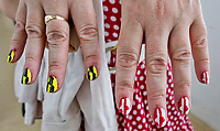 BALTIMORE, MD - MAY 20: A woman poses for a photo of her Preakness themed nails on Preakness Stakes Day at Pimlico Race Course on May 20, 2017 in Baltimore, Maryland.(Photo by Scott Serio/Eclipse Sportswire/Getty Images)