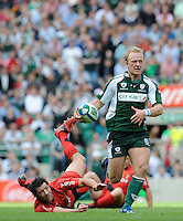 Twickenham, GREAT BRITAIN, Exiles' Shane GERAGTHY, leaves the tackle Bryon KELLENER [grounded] during the Heineken, Semi Final, Cup Rugby Match,  London Irish vs Toulouse, at the Twickenham Stadium on Sat 26.04.2008 [Photo, Peter Spurrier/Intersport-images]