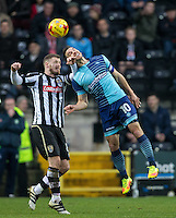 Matt Bloomfield of Wycombe Wanderers goes up against Michael O'Connor of Notts County during the Sky Bet League 2 match between Notts County and Wycombe Wanderers at Meadow Lane, Nottingham, England on 10 December 2016. Photo by Andy Rowland.