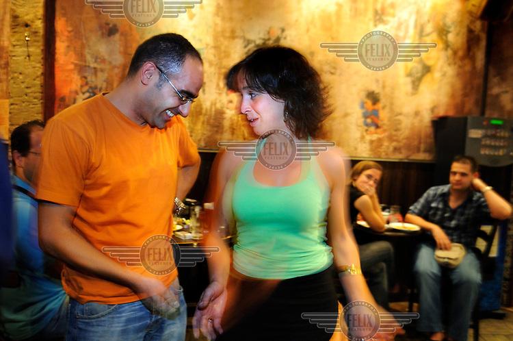 A couple dancing in a tapas bar, close to Plaza de Santa Ana.