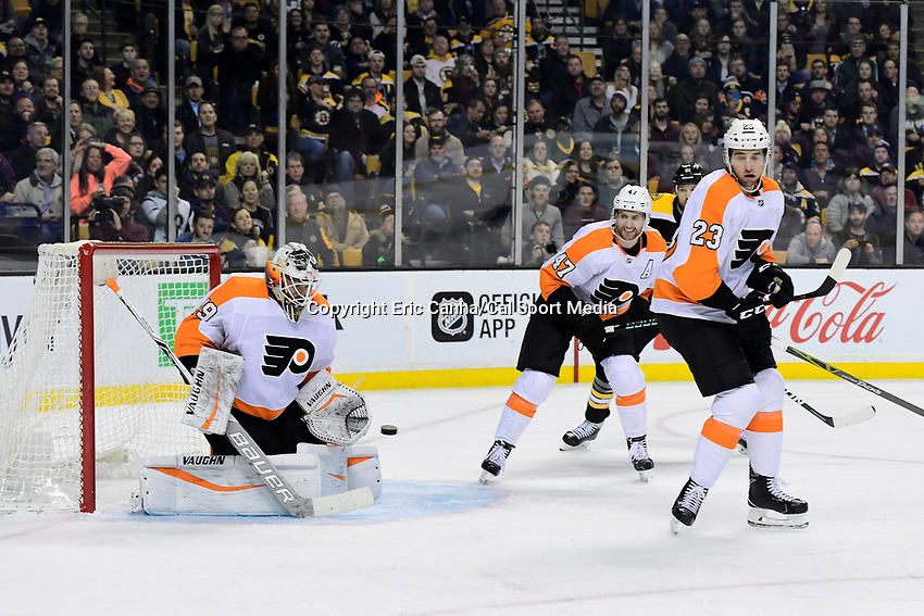 March 8, 2018: Philadelphia Flyers goaltender Alex Lyon (49) makes a save during the NHL game between the Philadelphia Flyers and the Boston Bruins held at TD Garden, in Boston, Mass. Boston defeats Philadelphia 3-2 in regulation time. Eric Canha/CSM