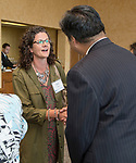Julie Pully is introduced to DePaul President A. Gabriel Esteban, Ph.D., as he and his wife Josephine attend a reception Thursday, July 20, 2017, at The Chicago Club. The event was organized to welcome the Estebans to Chicago and introduce them to some of Chicago&rsquo;s most influential women. <br /> (DePaul University/Jamie Moncrief)