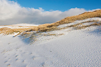 Snow covered sand dunes and grass, Isle of Harris, Scotland