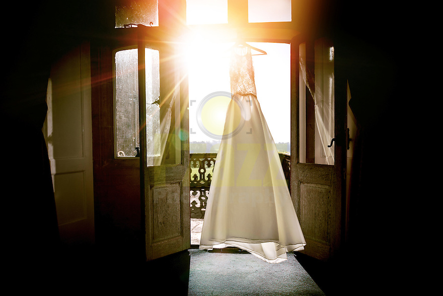 The Brides Wedding Dress hanging in window