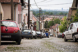 SERBIA, Belgrade, Old cars on a cobblestone street in the Zemun neighborhood, Eastern Europe