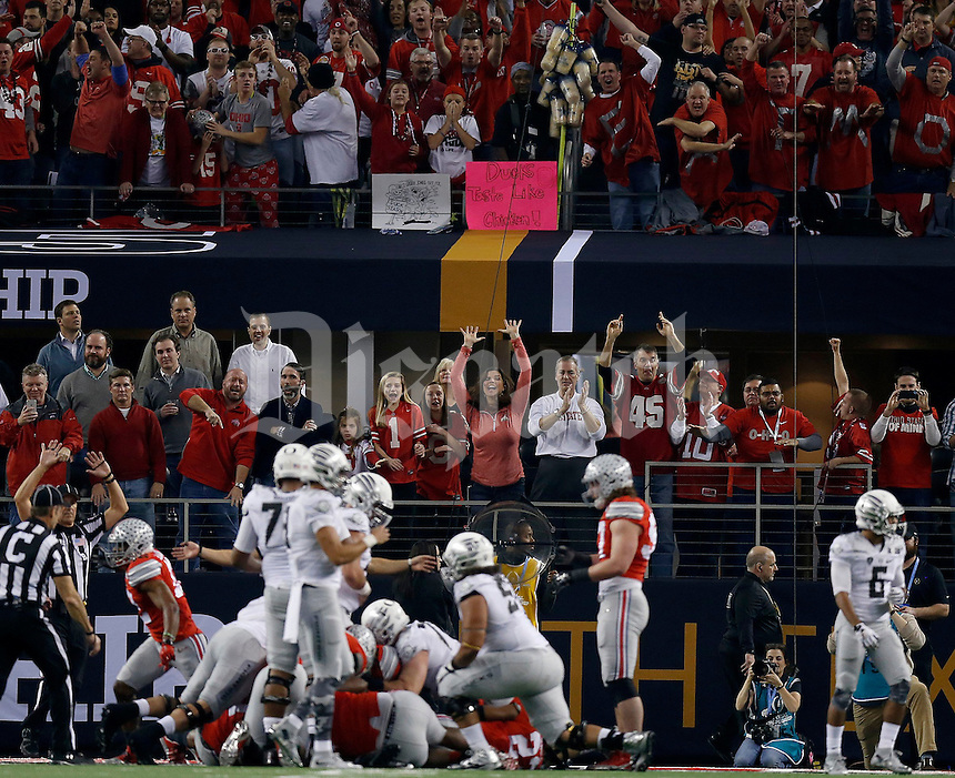 The crowd reacts after the Ohio State Buckeyes stopped the Oregon Ducks on fourth down during the second quarter the College Football Playoff National Championship at AT&T Stadium in Arlington, TX on Monday, January 12, 2015. (Columbus Dispatch photo by Jonathan Quilter)