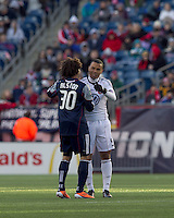 DC United forward Charlie Davies (9) greets New England Revolution defender Kevin Alston (30). In a Major League Soccer (MLS) match, the New England Revolution defeated DC United, 2-1, at Gillette Stadium on March 26, 2011.