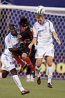 The Wizard's Shavar Thomas and Jimmy Conrad go up for a header with the MetroStars' Sergio Galvan Rey. The Kansas City Wizards were defeated by  the NY/NJ MetroStars to a 1 to 0 at Giant's Stadium, East Rutherford, NJ, on May 30, 2004.
