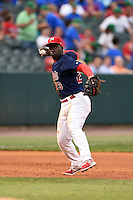 Memphis Redbirds third baseman Jermaine Curtis (23) throws to first during a game against the Oklahoma City RedHawks on May 23, 2014 at AutoZone Park in Memphis, Tennessee.  Oklahoma City defeated Memphis 12-10.  (Mike Janes/Four Seam Images)