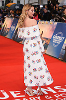 Lily James at 'The Guernsey Literary and Potato Peel Pie Society' film premiere, London, UK. <br /> 09 April  2018<br /> Picture: Steve Vas/Featureflash/SilverHub 0208 004 5359 sales@silverhubmedia.com