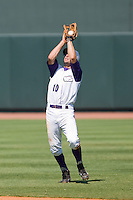 Second baseman Andrew Garcia #10 of the Winston-Salem Dash catches a fly ball in shallow right field against the Lynchburg Hillcats at  BB&T Ballpark July 11, 2010, in Winston-Salem, North Carolina.  Photo by Brian Westerholt / Four Seam Images