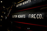 Hoses with the company name are displayed on an antique fire truck in Clifton Heights Pennsylvania