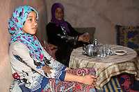 Morocco.  Young Amazigh Berber Girl Ait Benhaddou Ksar, a World Heritage Site.  Mother in Background.