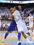 Kentucky Wildcats guard Andrew Harrison (5) and North Carolina guard Nate Britt fight for the ball during the UK men's basketball vs. North Carolina at the Dean Smith Center in Chapel Hill, N.C., on Saturday, December 14, 2013. Photo by Emily Wuetcher | Staff