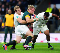 Adriaan Strauss of South Africa is tackled by Joe Launchbury of England. Old Mutual Wealth Series International match between England and South Africa on November 12, 2016 at Twickenham Stadium in London, England. Photo by: Patrick Khachfe / Onside Images