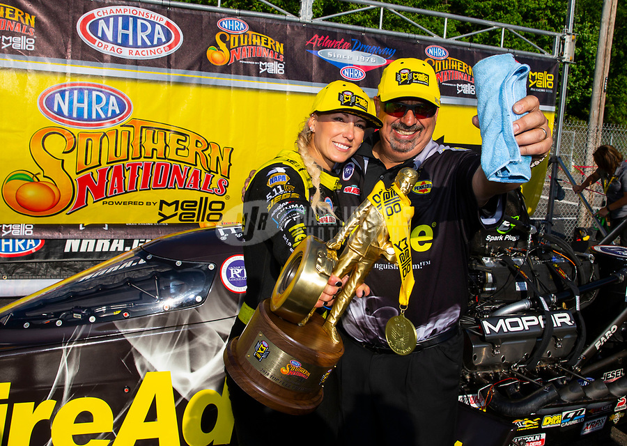 May 6, 2018; Commerce, GA, USA; NHRA top fuel driver Leah Pritchett celebrates with crew members after winning the Southern Nationals at Atlanta Dragway. Mandatory Credit: Mark J. Rebilas-USA TODAY Sports