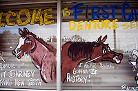 Window paintings announce the 100th anniversary of the Pendleton Roundup on storefronts in Pendleton, Oregon, USA.  The Pendleton Roundup is one of the 10 largest rodeos in the world.