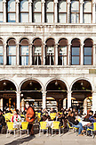 ITALY, Venice. Tourists sitting at a cafe in St. Mark's Square.
