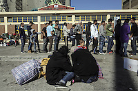Pictured: Migrants rest on the ground Thursday 03 March 2016<br />