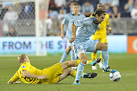 Graham Zusi Sporting KC evades the tackle from Kevin Burns (15) Columbus Crew... Sporting Kansas City defeated Columbus Crew 2-1 at LIVESTRONG Sporting Park, Kansas City, Kansas.