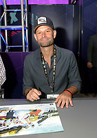 SAN DIEGO COMIC-CON© 2019:  20th Century Fox Television and Hulu's Solar Opposites Executive Producer Josh Bycel during the Solar Opposites booth signing on Friday, July 19 at the SAN DIEGO COMIC-CON© 2019. CR: Alan Hess/20th Century Fox Television