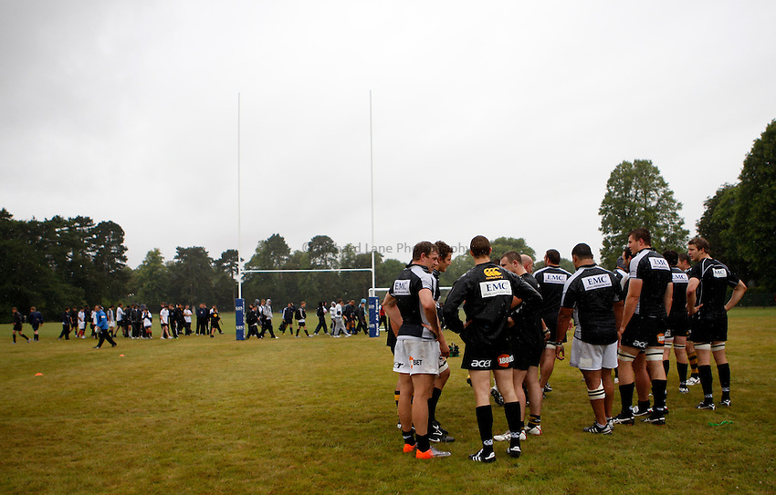 Photo: Richard Lane/Richard Lane Photography. London Wasps training at RAF Halton as part of an CoacHclass Wasps and RAF lead rugby coaching 3 day course for young rugby players. 10/08/2010. The London Wasps squad train in front of young rugby players.