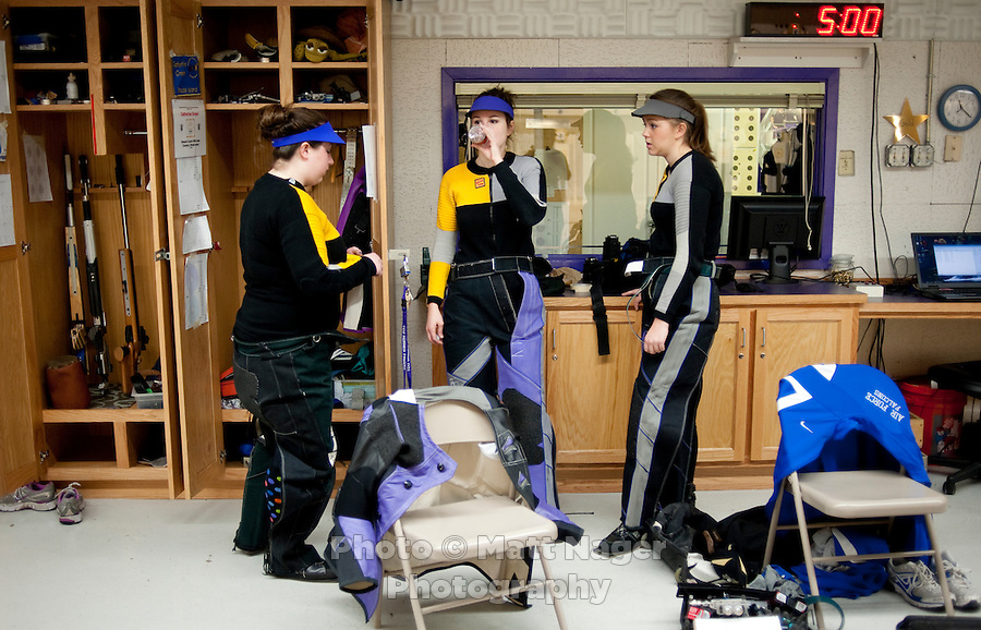 Catherine Green (cq, left), Sarah Beard (cq, middle), and Caitlin Morrissey (cq, right), with the Texas Christian University Women's Rifle Team, take a break during a qualifying shooting match at the TCU campus in Ft. Worth, Texas, Saturday, February 12, 2011. The TCU team is undefeated this season and won the national championship last year to become the first all women's team to win the championship...CREDIT: Matt Nager for The Wall Street Journal