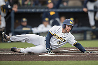 Michigan Wolverines shortstop Michael Brdar (9) slides safely home against the Michigan State Spartans on May 19, 2017 at Ray Fisher Stadium in Ann Arbor, Michigan. Michigan defeated Michigan State 11-6. (Andrew Woolley/Four Seam Images)