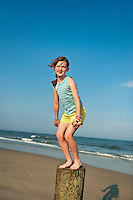 Young girl on summer vacation at the beach.