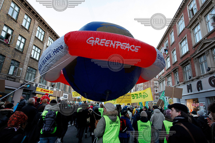 Globe with lifesaver made by Greenpeace during at a big demonstration held in Copehangen on Dec 12. United Nations Climate Change Conference (COP15) was held at Bella Center in Copenhagen from the 7th to the 18th of December, 2009. A great deal of groups tried to voice their opinion and promote their cause in various ways. The conference and demonstrations was covered by thousands of photographers and journalists from all over the world...©Fredrik Naumann/Felix Features.