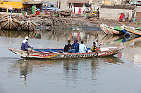 Senegal, Saint Louis.  Canoe Ferrying Passengers across the Senegal River, from Ile de N'Dar to Guet N'Dar Neighborhood on the Langue de Barbarie Peninsula.