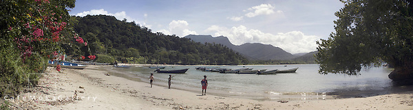 Las Cuevas Bay with children and fishing boats. Panoramic multishot