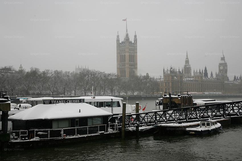 Weather, climate change. London, Britain and Europe, is gripped by a big freeze. Winter conditions which are likened to Siberia swept across Europe, bringing traffic and transport to a halt, closing schools and stopping millions of people going to work. Whilst most buses and tubes were not working, some commuters and tourists got to central London to enjoy the freak snow.///Thames cruises, Lambeth pier, the Houses of Parliament at Westminster and the river Thames in the snow
