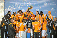Houston Dynamo midfielder Brad Davis (11) celebrates with teammates the Eastern Conference Championship.  D.C. United tied The Houston Dynamo 1-1 but lost in the overall score 4-2 in the second leg of the Eastern Conference Championship at RFK Stadium, Sunday November 18, 2012.