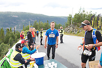 Race number 205 -  Ernst Olav Botnen.Race number 163 - Nicolas Gregoire - Norseman 2012 - Photo by Justin Mckie Justinmckie@hotmail.com