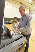 NWA Democrat-Gazette/FLIP PUTTHOFF <br /> Louisa Terrick (cq) (left), poll worker, helps Bill Freeze cast his ballot Tuesday March 12 2019 during the sales tax election to fund a new courthouse and upgrade the existing courthouse. Freeze voted at Bentonville Church of Christ.