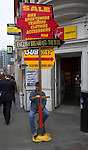Man holding sign for discount sales, Bishopsgate, London, England