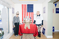 """Zoila Oliva, 76, (left), of Hialeah, and Blanca Vrotsos, 62, of Doral, pose for a picture with a display of Democratic party officials entitled """"The Real Deplorables"""" at the Donald Trump campaign office in Hialeah, Miami, Florida, on Sun., Oct. 9, 2016.  The two were volunteering in the campaign phone bank. """"The Real Deplorables"""" is a reference to Hillary Clinton's remarks during a campaign speech that half of Trump's supporters are """"deplorable."""""""