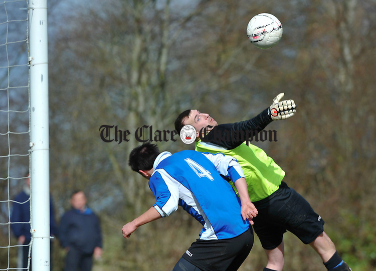 Rhys Phillips and goalie Joe Burke of Hermitage A defend the goals during their Premier League game against Newmarket Celtic A at Newmarket. Photograph by John Kelly.