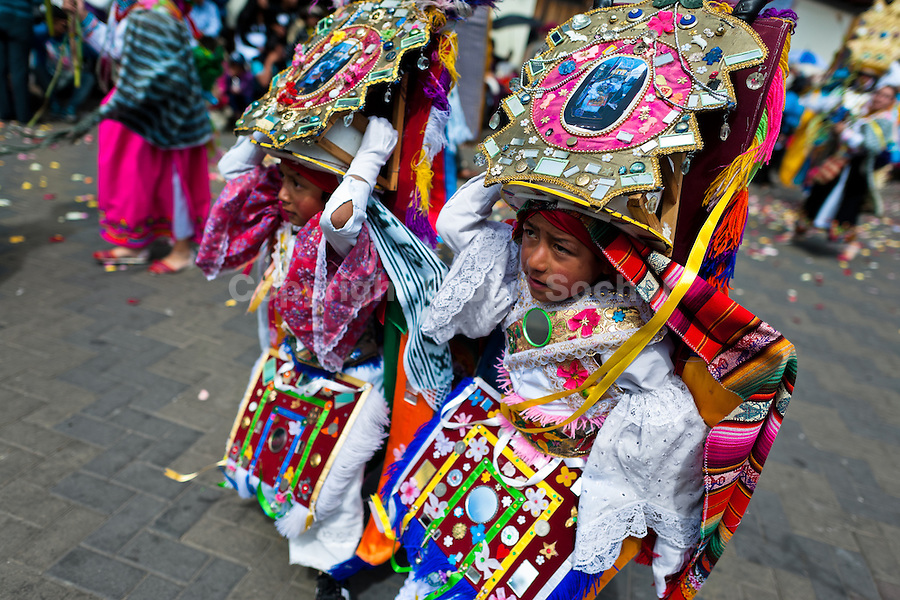 Young dancers (danzantes) take part in the religious parade within the Corpus Christi festival in Pujilí, Ecuador, 10 June 2012. Every year in June, thousands of people gather in a small town of Pujili, high in the Andes, to celebrate the Catholic feast of Corpus Christi. Introduced originally during the Spanish conquest of South America, this celebration merges Catholic rituals of Holy Communion with the traditional Andean harvest and sun festivities (Inti, the Inca sun god). Women dancers perform wearing brightly colored costumes while men dancers wear chest ornaments and heavy elaborate headdresses adorned with mirrors, jewelry, or natural items (shells). Being a dancer in the Corpus Christi ceremonial parade (El Danzante) is considered an honour and a privilege by the indigenous people in Ecuador.