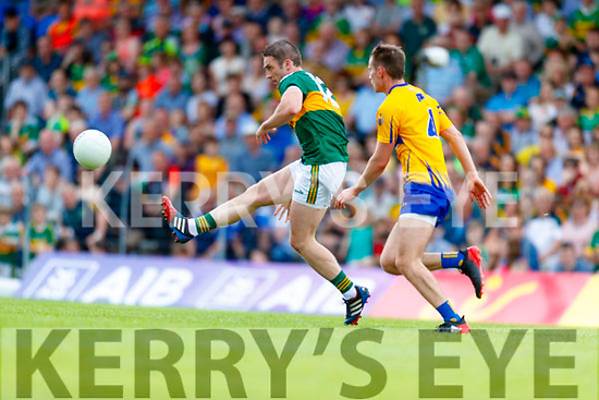Stephen O'Brien Kerry in action against Eoghan Collins Clare during the Munster GAA Football Senior Championship semi-final match between Kerry and Clare at Fitzgerald Stadium in Killarney on Sunday.