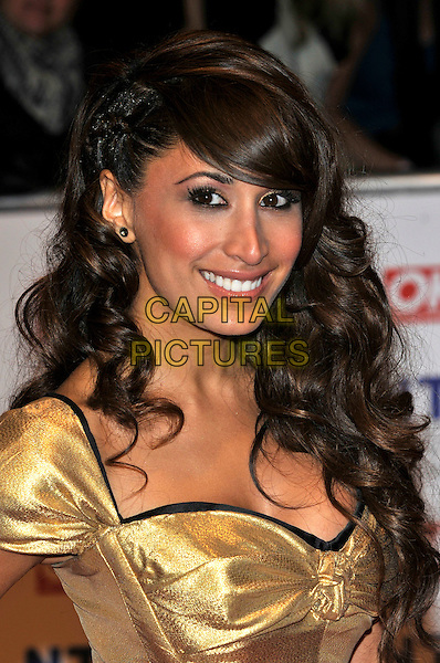 PREEYA KALIDAS.The 15th National Television Awards held at the O2 Arena, London, England..January 20th, 2010.NTA NTAs headshot portrait gold metallic .CAP/PL.©Phil Loftus/Capital Pictures.