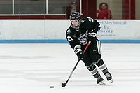 BOSTON, MA - JANUARY 11: Isabelle Hardy #21 of Providence College brings the puck forward during a game between Providence College and Boston University at Walter Brown Arena on January 11, 2020 in Boston, Massachusetts.