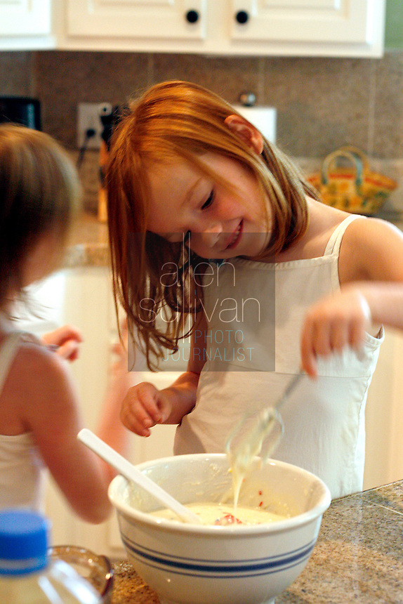 Abigayle Wood, 5, helps make her birthday cake at home in Lawrenceville, Ga. on Sunday, Sept. 10, 2006. Abigayle was born on Sept. 11, 2001. Anna Marie Wood said the attacks on that day caused her to go into early labor.<br />